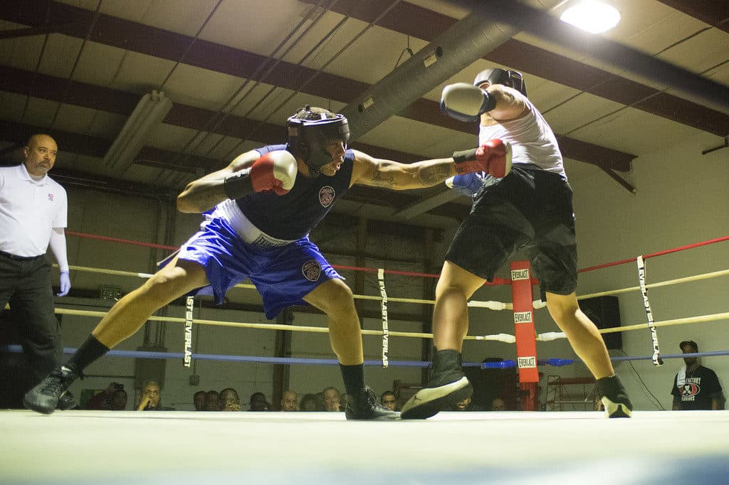JOED VIERA/STAFF PHOTOGRAPHER Niagara Falls, NY- Rico Hernandez(red) and Nolan Smith(blue) box during a match at Casal's Boxing Gym.